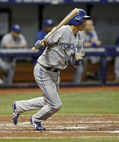 Toronto Blue Jays' Munenori Kawasaki follows through on an RBI single during the third inning of a baseball game against the Tampa Bay Rays Friday, July 11, 2014, in St. Petersburg, Fla. (AP Photo/Mike Carlson)