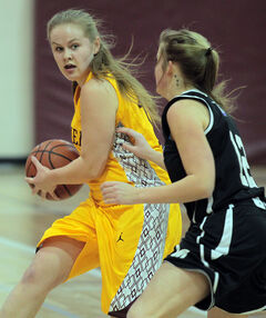 Frances Krinke of the Crocus Plainsmen looks for a passing lane from the perimeter during Tuesday night's varsity girls' basketball game against the Vincent Massey Vikings.