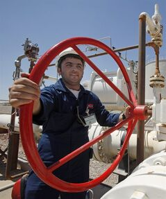 FILE - In this May 31, 2009 file photo, an employee works at the Tawke oil fields in the semiautonomous Kurdish region in northern Iraq. Iraq's self-ruled northern Kurdish region said Friday that it has made its first oil shipment through its own pipeline to the international market, bypassing the central government in Baghdad, which insists that it has the sole right to develop and market the country's natural resources. (AP Photo/Hadi Mizban, File)