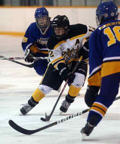 Brandon's Josh Kobelka looks for an opening in the Yellowhead defence.