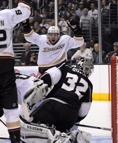 Los Angeles Kings goalie Jonathan Quick, center, is scored on by Anaheim Ducks right wing Corey Perry as defenseman Sami Vatanen, of Finland, looks on during the first period in Game 3 of an NHL hockey second-round Stanley Cup playoff series, Thursday, May 8, 2014, in Los Angeles. (AP Photo/Mark J. Terrill)