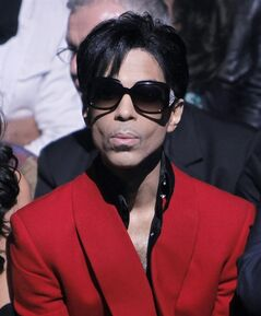 FILE - In this Oct. 7, 2009 file photo, U.S singer Prince attends John Galliano's Spring-Summer 2010 fashion collection, presented in Paris. (AP Photo/Thibault Camus, file)