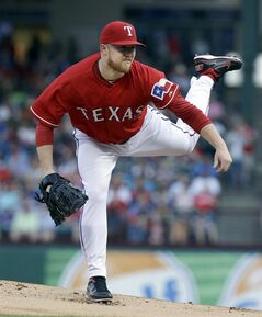 Texas Rangers starting pitcher Robbie Ross Jr. follows through on a pitch during the first inning of a baseball game against the Toronto Blue Jays in Arlington, Texas, Saturday, May 17, 2014. (AP Photo/LM Otero)