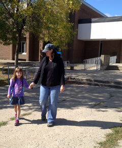 Jackie Bolack walks with her daughter Madison, 6, at Meadows School on Wednesday, which was the first day of classes across the Brandon School Division.