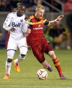 Vancouver Whitecaps' Darren Mattocks, left, and Real Salt Lake's Nat Borchers go for the ball during an MLS soccer game in Sandy, Utah, Saturday, April 26, 2014. (AP Photo/Deseret News, Kristin Murphy) SALT LAKE TRIBUNE OUT; MAGAZINES OUT; MANDATORY CREDIT