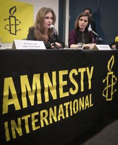 "Members of the punk band Pussy Riot, Maria ""Masha"" Alyokhina, left, and Nadezhda ""Nadya"" Tolokonnikova, right, hold a news conference at Amnesty International's New York headquarters, on Tuesday Feb. 4, 2014 in New York. They were released from Russian prison in December, after nearly two years in jail following a conviction for hooliganism when they staged a protest in a Russian church, in what was widely seen as a public relations move ahead of the Olympics by Russian President Vladimir Putin. (AP Photo/Bebeto Matthews)"