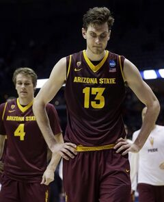 Arizona State center Jordan Bachynski (13) and guard Bo Barnes (4) walk off the court after Texas defeated Arizona State 87-85 in a second-round game of the NCAA college basketball tournament Thursday, March 20, 2014, in Milwaukee. Bachynski has only a handful of NBA cities left to visit ahead of next week's draft in what's been a gruelling few weeks of workouts. THE CANADIAN PRESS/ AP /Morry Gash