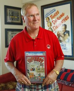 In this photo taken on May 19, 2014, John C. Wise, poses in his San Diego home with a 1966 Super Boy comic. Though Super Boy is not for sale, he is auctioning off some rare historic comic books from his collection. (AP Photo/U-T San Diego, K.C. Alfred) NO SALES, NO ARCHIVING, TV OUT, MAGS OUT, TABLOIDS OUT.