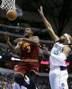 CORRECTS NAME TO DION WAITERS NOT SHANE LARKIN Cleveland's Dion Waiters (3) has the ball knocked away on a shot attempt by Dallas Mavericks' Vince Carter (25) in the first half of an NBA basketball game, Monday, Feb. 3, 2014, in Dallas. (AP Photo/Tony Gutierrez)
