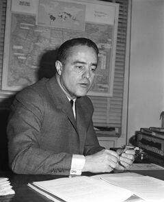FILE - This Dec. 23, 1963 file photo shows Peace Corps Director R. Sargent Shriver in his Washington office. His diaghter, Maria Shriver is launching a new U.S. volunteer initiative called the Shriver Corps, named in part to honor the legacy of her late father, who founded the Peace Corps. Shriver Corps volunteers will help Americans in need connect with programs they're entitled to but that they may not be aware of. (AP Photo/File)