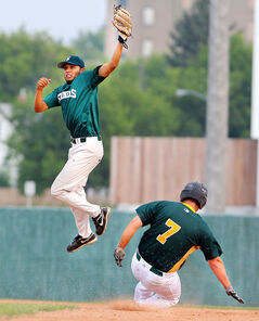 Manitoba Senior Baseball League all-star Isaac Rodriguez leaps into the air to make a catch at second base as Winnipeg Senior Baseball League all-star Reid Ferguson slides in safely during the third inning of Saturday evening's Broken Bat Classic at Andrews Field. The MSBL all-stars won the game 4-2.