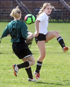 Vincent Massey's Mia Pappas, right, kicks the ball past a Neelin opponent during the Brandon High School Soccer League girls' final on Thursday afternoon at Massey. The Spartans won 1-0 to advance to the provincial urban championship, May 30 and 31 in Winnipeg.