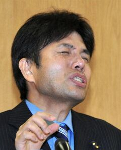 In this Tuesday, July 1, 2014 photo, Hyogo Prefectural assemblyman Ryutaro Nonomura gestures as he speaks during a press conference in Kobe, western Japan. A video clip of Nonomura accused of dubious spending has gone viral, leaving many outraged and puzzled. The video shows Nonomura, 47, bursting into tears, uttering nonsensical phrases and banging on the desk. One site for the video drew nearly 640,000 views, as of Thursday. (AP Photo/Kyodo News) JAPAN OUT, MANDATORY CREDIT