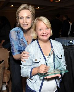 File-This Oct. 10, 2012, file photo shows actresses Jane Lynch, left, and Lauren Potter, right, attending the 2012 Media Access Awards in Beverly Hills, Calif. Lynch will attend the opening ceremony of the Special Olympics USA Games on Sunday, June 15, 2014,possibly with her signature tracksuit and bullhorn, whipping up the expected crowd of 18,000 at the Prudential Center in Newark, New Jersey. (Photo by John Shearer/Invision for Media Access Awards/AP Images, File)