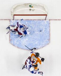 Philadelphia Flyers' Jakub Voracek, center, of the Czech Republic, watches his puck come back out of the net after a goal against New York Rangers' Henrik Lundqvist, top, of Sweden, with Marc Staal, bottom, defending during the second period in Game 4 of an NHL hockey first-round playoff series on Friday, April 25, 2014, in Philadelphia. (AP Photo/Chris Szagola)