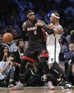 Miami Heat forward LeBron James (6) looks to drive against Brooklyn Nets forward Paul Pierce (34) in the third period during Game 3 of an Eastern Conference semifinal NBA playoff basketball game, Saturday, May 10, 2014, in New York. LeBron James understands it will take time but he wants Donald Sterling out of the NBA. And he said Sunday that NBA players believe nobody in Sterling's family should be able to own the Los Angeles Clippers if he's gone. THE CANADIAN PRESS/AP, Julie Jacobson