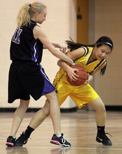 Crocus' Lucy Sunwoo and Massey's Shayla Heinrichs battle for the ball.