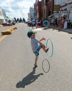 Four-year-old Jack Polasek spins a hula hoop from his arm to his leg in the middle of Main Street in Carberry, which was closed for the heritage festival on Saturday.