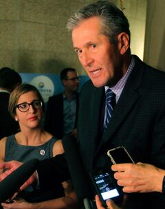 "Premier Brian Pallister, pictured at the legislature on Wednesday, was referring to escalation tensions over night hunting when he said it is becoming a ""race war,"" according to his director of communications. Olivia Baldwin-Valainis also said that Pallister ""would rephrase given the opportunity."""