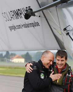 Solar Impulse co-founder Bertrand Piccard, left, congratulates German test pilot Markus Scherdel, right, after its maiden flight with the solar-powered Solar Impulse 2 aircraft at its base in Payerne, Switzerland Monday June 2, 2014. The aircraft is the second solar plane of the Solar Impulse project. The main goal of the project is to circumnavigate the world with an aircraft, powered only by solar energy. ((AP Photo/Denis Balibouse,Pool)