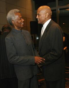 FILE - In this Oct. 6, 2006, file photo, filmmaker William Greaves, left, and talks with actor Harry Belafonte at the 80th anniversary celebration of Harlem's Schomburg Center at Jazz at Lincoln Center in New York. Greaves, the Emmy-award winning producer and co-host of the groundbreaking television show