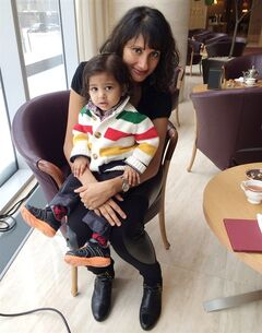 Bhargavi Varma poses with her 16-month-old son, Aditya, in Toronto on Feb. 5, 2014. The Toronto blogger has created a Twitter account on her son's behalf. THE CANADIAN PRESS/HO-Bhargavi Varma