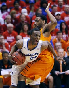 Kansas guard Andrew Wiggins (22) is fouled by Oklahoma State guard Brian Williams during the first half of an NCAA college basketball game at Allen Fieldhouse in Lawrence, Kan., Saturday, Jan. 18, 2014. (AP Photo/Orlin Wagner)