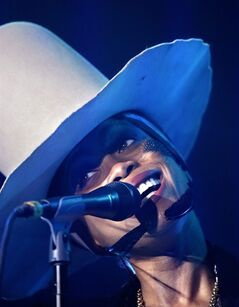 Erykah Badu performs at the Essence Festival in New Orleans, Sunday, July 6, 2014. (AP Photo/Gerald Herbert)