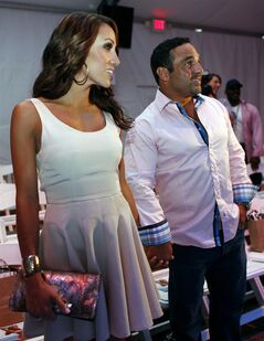 FILE - In this July 22, 2012 file photo, Real Housewives of New Jersey's Melissa Gorga, left, poses with her husband Joe during the Mercedes-Benz Fashion Week Swim 2013 show in Miami Beach, Fla. A judge on Thursday, July 17, 2014 ruled a tenant who is renting the Gorgas' Montvale, N.J. home may stay for 17 more days provided he makes a $25,000 payment. (AP Photo/Lynne Sladky, File)