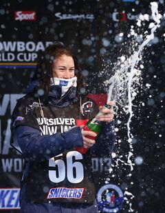 Enni Rukajarvi from Finland celebrates after winning the slope style women's snowboard World Cup event in Spindleruv Mlyn, Czech Republic, Saturday, March 16, 2013. (AP Photo/Petr David Josek)