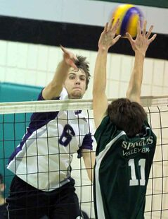 Neelin's Adam Helwer tries to block a hit by Vincent Massey's Joel Rocan.