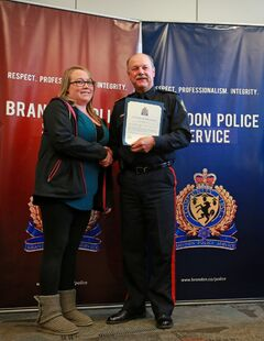 Licensed practical nurse Krista Andronick receives a Citizen Recognition Award from Brandon Police Service Chief Ian Grant during Tuesday's ceremony afternoon. Andronick received the award for assisting with CPR at the scene of a car accident.