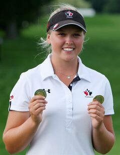 Brooke Henderson, of Canada, celebrates with medals for the Top Canadian and the Top Amateur following the Canadian Pacific Women's Open golf tournament in London, Ont., on Sunday, Aug. 24, 2014. Explaining why women find the spotlight in golf so much younger than men has a lot do with body mechanics and a little to do with advances in teaching and technology that have been refined over time. THE CANADIAN PRESS/Dave Chidley