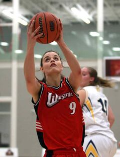 Brandonite Tia Coulter of the Winnipeg Wesmen women's basketball team takes the ball to the hoop in Saturday's game against the Bobcats at Brandon University's new HLC.