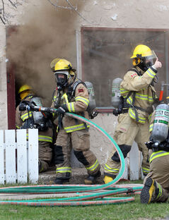 Firefighters respond to a house fire on the 500-block of Seventh Street early Tuesday evening.