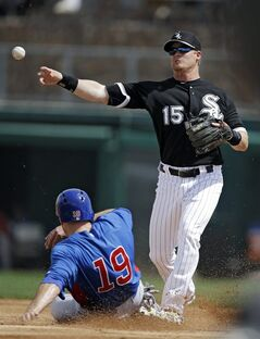 Chicago White Sox second baseman Gordon Beckham (15) fires over Chicago Cubs' Nate Schierholtz (19) to complete a double play on the Cubs' Scott Hairston in the second inning of an exhibition spring training baseball game Friday, March 15, 2013, in Glendale, Ariz. (AP Photo/Mark Duncan)