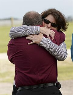 Debbi Hobbs, the aunt of Kimberly Waters, hugs Kimberly's uncle, Tom Brimer, in front of the Florida State Prison near Starke, Fla., Thursday, July 10, 2014 after the execution of Eddie Wayne Davis. Davis was convicted of the 1994 rape and slaying of Kimberly, 11. It was the state's sixth execution this year. (AP Photo/Phil Sandlin)