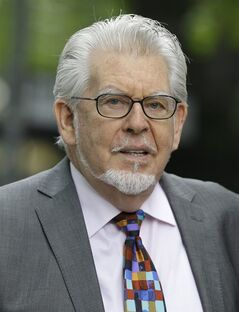 Veteran Australian-British entertainer Rolf Harris who is accused of indecent assault arrives at Southwark Crown Court in London, Friday, May 9, 2014. The 84-year-old is charged with indecently assaulting four girls between 1968 and 1986. The girls ranged in age from 7 or 8 to 19. Harris denies the charges. (AP Photo/Kirsty Wigglesworth)