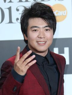 Chinese concert pianist Lang Lang arrives for the Classic BRIT Awards at the Royal Albert Hall in central London, Wednesday, Oct. 2, 2013. (Photo by Joel Ryan/Invision/AP)
