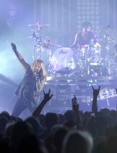 Lead singer Vince Neil whips up the crowd during Monday night's concert.