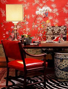 In this photo provided by Burnham Design, bold red wallpaper and upholstery are combined with neutral colors to create a lively but cohesive design for this home office, created by Betsy Burnham of Burnham Design. (AP Photo/Burnham Design, Grey Crawford)