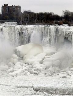 FILE - This Jan. 10, 2014 file photo shows the US side of Niagara Falls in New York beginning to thaw after the recent