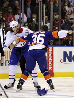 New York Islanders left wing Eric Boulton (36) and Montreal Canadiens right wing George Parros (15) fight in the first period of an NHL hockey game at Nassau Coliseum in Uniondale, N.Y., Saturday, Dec. 14, 2013. (AP Photo/Kathleen Malone-Van Dyke)