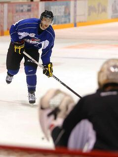 Chad Robinson prepares to take a shot in Wheat Kings practice Thursday.