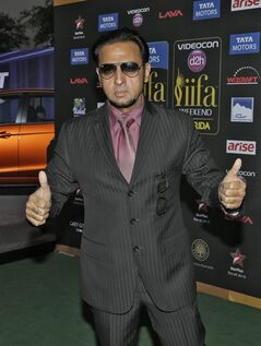 Indian film star Gulshan Grover poses for photographers as he walks the green carpet for 15th annual International Indian Film Awards Saturday, April 26, 2014, in Tampa, Fla. (AP Photo/Chris O'Meara)