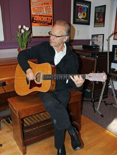 In this photo made Dec. 18, 2013, Bobby Vee playing the guitar at his family's Rockhouse Productions in St. Joseph, Minn. Alzheimer's disease forced the 1960s pop idol to stop performing in 2011 and now 70, Vee is releasing what may be the capstone to his career,