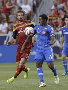 Montreal Impact's Patrice Bernier (8) and Real Salt Lake's Kyle Beckerman (5) battle for the ball in the first half during an MLS Soccer game on Thursday, July 24, 2014, in Sandy, Utah. (AP Photo/Rick Bowmer)