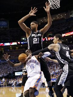 San Antonio Spurs guard Danny Green (4) knocks the ball away from Oklahoma City Thunder guard Reggie Jackson (15) in front of Spurs forward Tim Duncan (21) in the first quarter of Game 4 of the Western Conference finals NBA basketball playoff series in Oklahoma City, Tuesday, May 27, 2014. (AP Photo/Sue Ogrocki)