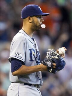 Tampa Bay Rays pitcher David Price blows a bubble after giving up a home run to Houston Astros' Dexter Fowler during the first inning of a baseball game, Sunday, June 15, 2014, in Houston. (AP Photo/Patric Schneider)