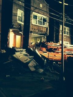 This photo provided by the New York City Fire Department shows a cement truck that slammed into a 3-story home in the Bronx borough of New York, Monday, Jan. 20, 2014. Officials say the driver of the truck was killed and several other people were injured. (AP Photo/New York City Fire Department)